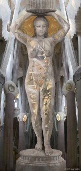 A caryatid stands in a cathedral, a golden halo behind her head, and machinery visible within her body.